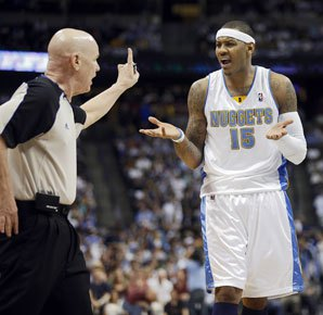New York Knicks Forward Carmelo Anthony argues with Joey Crawford while he was still playing in Denver. (via Sports Illustrated)