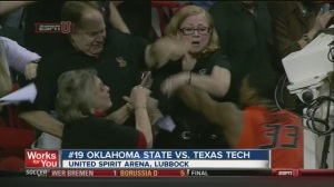 A shot of Jeff Orr (man on the left) and Oklahoma State Guard Marcus Smart during Saturday's altercation in Lubbock.  Texas Tech won the game 65-61. (photo via KJRH-TV)