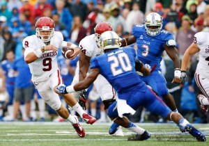 Oklahoma QB Trevor Knight dodges a tackle from Tulsa Safety Demarco Nelson during Saturday's rout in Tulsa. (DallasNews.com)