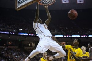 Myles Turner slams home 2 of his 15 points in his first game at Texas on Friday. (Daily Texan Online)