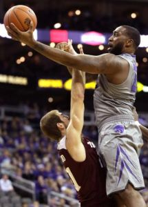 Kansas State, in their 2nd year under Bruce Weber, currently owns the worst record in the Big 12, 7-4.  However they won on Saturday against former conference foe, Texas A&M. (AP)
