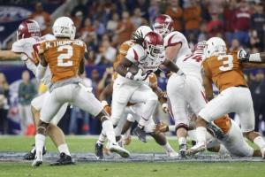 Texas and Arkansas renewed an old Southwest Conference rivalry in this year's Advocare V100 Texas Bowl, with the Razorbacks knocking off Charlie Strong's Longhorns, 31-7.  (Bleacher Report)