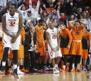 Norense Odiase (left) and Toddrick Gotcher (center) of Texas Tech celebrate the Red Raiders' 63-62 win over Oklahoma State at United Supermarkets Arena in Lubbock.  The win is TTU's second straight over the Pokes in Lubbock. (Tulsa World)