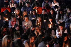Hundreds, possibly thousands of Oklahoma State University students attended a candlelight vigil outside the school's Student Union on Sunday following a tragic accident at the Sea of Orange Homecoming Parade on Saturday. (csmonitor.com)